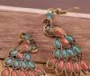 Павлины красно-бирюзового цвета
