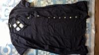 Плаття чорне, приталене,оздоблене на спинці, по переду на гудзиках.