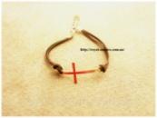 Браслет «Крест» коричневый на ремешке.
