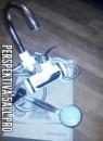 Проточный электрический водонагреватель с душем настенный