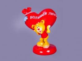 Фігурка декоративна «Ведмедик з мішком» 7х6х8 см